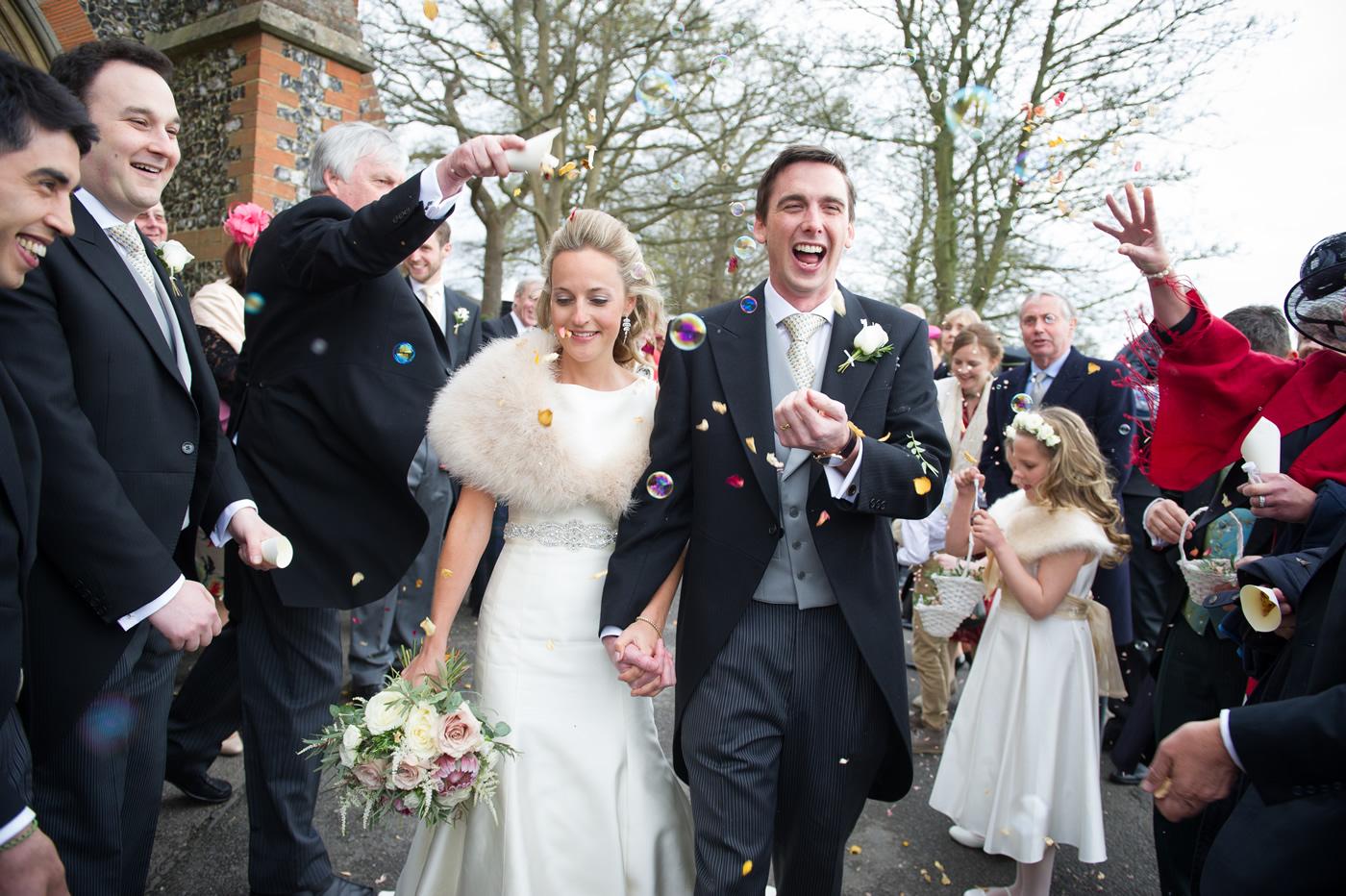 Just Married - Biride & Bride Leave Church - Weddings at Bradfield College Berkshire - Bridal Hair & Makeup by Anabela of Maidenhead