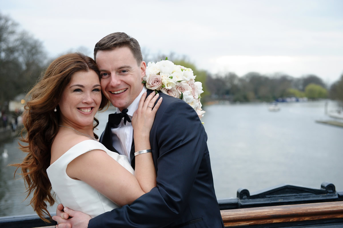 Bride & Groom Photo On Bridge Overlooking River Thames at Windsor Berkshire - Bridal Hair & Makeup by Anabela